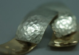 sterling silver and 14kt yellow gold earrings.