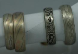 Four mokume-gane rings.woodgrain pattern