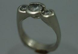 platinum ring for three diamonds. cut away center bezel