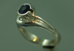 sterling silver engagement ring with sapphire and diamonds