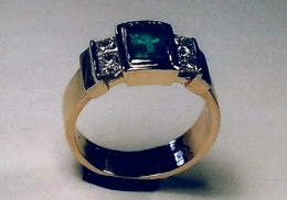 14kt. yellow and white gold wedding ring with emerald and diamonds.