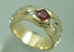 14kt yellow gold ladies wedding ring, with ruby and diamonds.