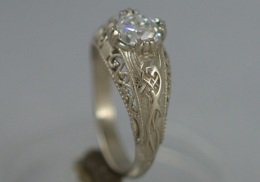 14kt white  gold  filigree engagement ring with.75 ct. diamond