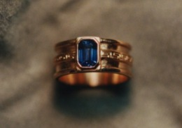 14kt rose gold wedding band with natural blue sapphire.