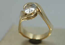 14kt yellow gold engagement ring with oval natural white sapphire