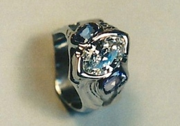 14kt white gold wedding ring with marquise diamond and oval blue zircons