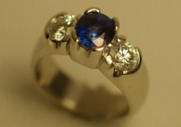 platinum engagement band with natural blue sapphire and diamonds