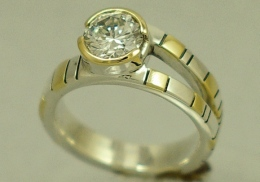 sterling silver and 14kt. yellow gold engagement ring with diamond.