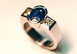 platinum engagement ring with natural blue sapphire and diamonds