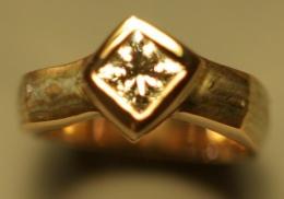14kt yellow gold wedding band with diamond and mokume-gane
